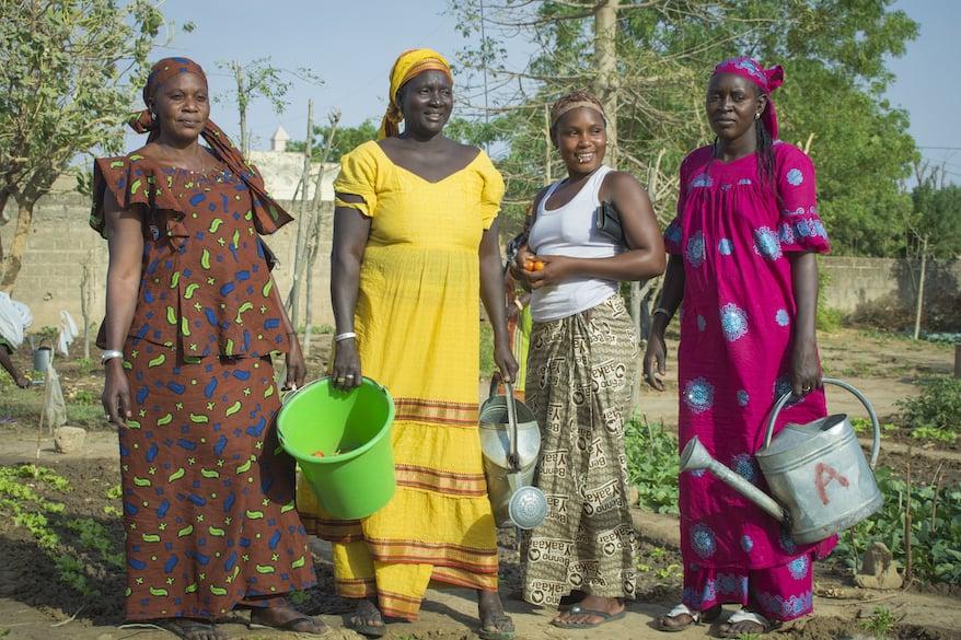 Women posing in garden